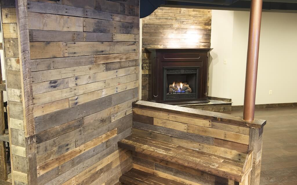 Rustic cigar lounge basement remodel essex home improvements for Rustic basement